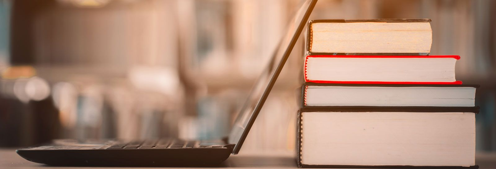Laptop and books banner image